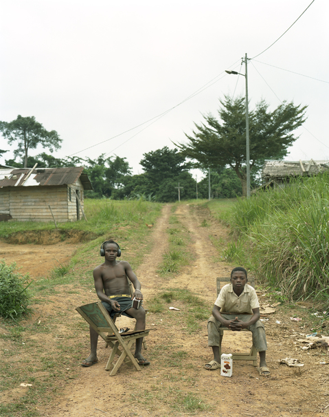<b>Republic of Dust</b> Village boys listening to music