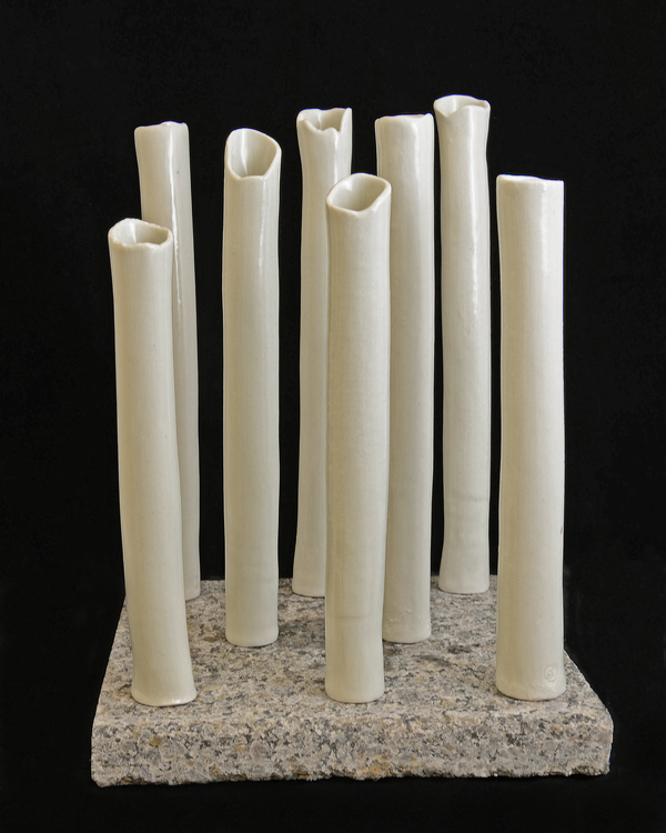 PHYLLIS SAVAGE ARCHITECTURE PORCELAIN TUBES ON GRANITE BLOCK