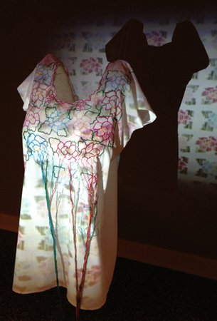 Steve Rossi Student Work Mexican embroidered wedding gown, video projection